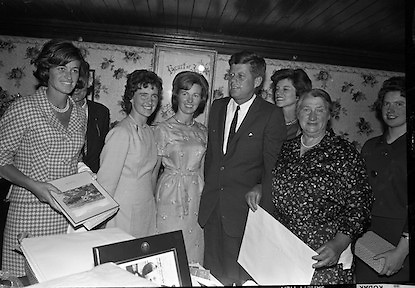 John F. Kennedy in Ireland.  President John F. Kennedy visits the homestead of his great-grandfather at Dunganstown, Co. Wexford and drinks a cup of tea with the present owner of the cottage, a second cousin of the President, Mrs. Mary Ryan (neé Kennedy). Included are Josephine Ryan, Mary Anne Ryan, Eunice Shriver, Matthew McCluskey and Frank Aiken..26.06.1963. The Kennedy Homestead, birthplace of President John F. Kennedy's great-grandfather Patrick Kennedy,<br /> <br /> john kennedy photo,<br /> photo john f kennedy,<br /> photo of john f kennedy,<br /> john f kennedy photo,<br /> jf kennedy,<br /> images john f kennedy,<br /> images of john f kennedy,