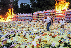 September 5, 2017 - Medan, North Sumatra, Indonesia - Ethnic-Chinese Indonesians burned 'hell money' as offerings for their ancestors' souls into the air during the 'hungry ghost' festival in Medan. During the month-long festival, Chinese people make offerings of food, hell money and paper-made models of items such as televisions, servants and cars to be burnt to appease the wandering spirits as it is believed that the gates of hell are opened during the month and their dead ancestors return to visit their relatives. (Credit Image: © Ivan Damanik via ZUMA Wire)