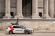 A car equipped with camera and mapping technology for the SatNav brand TomTom drives beneath the pillars and column architecture of Sir Christopher Wrens St Pauls Cathedral south transept, on 24th June 2021, in London, England.