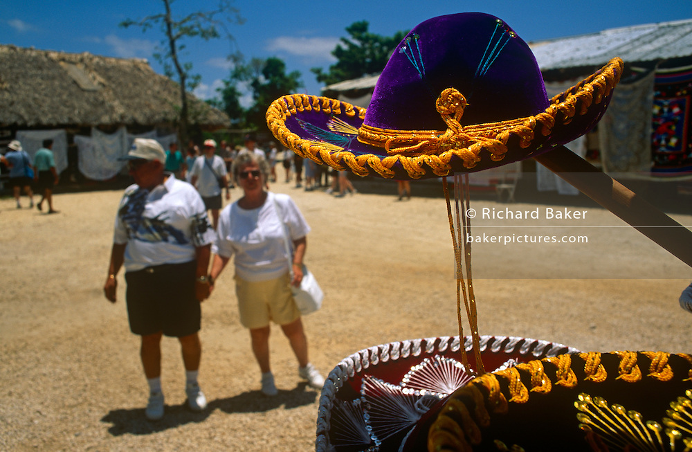 Tourists explore tourist sombrero trinket shops during their cruise ship excursion at Cancun.