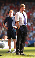 Photo: Henry Browne.<br /> Wales v England. FIFA World Cup Qualifying match.<br /> 03/09/2005.<br /> Wales manager John Toshack with England assistant coach Steve McClaren in the background.