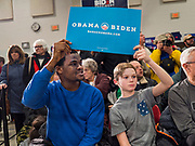 04 JANUARY 2020 - DES MOINES, IOWA: AZEEZ IDRIS, left, and EDDIE KENNEDY, 11, wait for former Vice President Joe Biden to arrive at a campaign event in Des Moines. Vice President Biden is touring Iowa this week to support his candidacy for the US Presidency. Iowa hosts the first presidential selection event of the 2020 election cycle. The Iowa caucuses are on February 3, 2020.     PHOTO BY JACK KURTZ