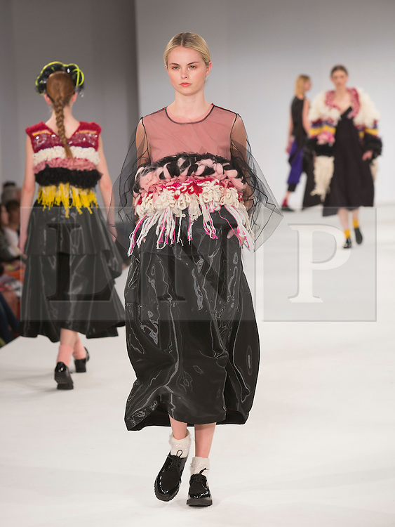 © Licensed to London News Pictures. 30/05/2015. London, UK. A model walks the runway during the UCA Rochester fashion show at Graduate Fashion Week 2015 wearing the collection of graduate student Lauren Pullen. Graduate Fashion Week takes place from 30 May to 2 June 2015 at the Old Truman Brewery, Brick Lane. Photo credit : Bettina Strenske/LNP