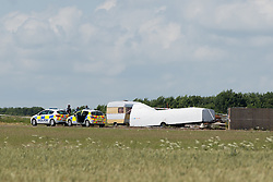 © Licensed to London News Pictures. 04/07/2015. <br /> Pictured: Police at the the scene of the crash where <br /> Two men have been killed in a Microlight crash at Enstone Airfield in Oxfordshire. Photo credit should read Max Bryan/LNP