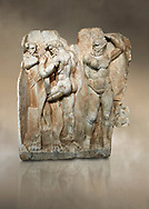 Roman Sebasteion relief sculpture of  Herakles is preparing to wrestle the Libyan giant Antaios. Aphrodisias Museum, Aphrodisias, Turkey. Against an art background.<br /> <br /> Herakles (left) is taking off his bow case to hang it on a pillar statue. Antaios (right) is binding up his head with ear protectors, next to him stands an oil basin used in the palaistra (wrestling ground). Antaios was a famous wrestler who challenged and killed all visitors to his country, until he was defeated by Herakles. .<br /> <br /> If you prefer to buy from our ALAMY STOCK LIBRARY page at https://www.alamy.com/portfolio/paul-williams-funkystock/greco-roman-sculptures.html . Type -    Aphrodisias     - into LOWER SEARCH WITHIN GALLERY box - Refine search by adding a subject, place, background colour, museum etc.<br /> <br /> Visit our ROMAN WORLD PHOTO COLLECTIONS for more photos to download or buy as wall art prints https://funkystock.photoshelter.com/gallery-collection/The-Romans-Art-Artefacts-Antiquities-Historic-Sites-Pictures-Images/C0000r2uLJJo9_s0