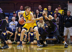 Mar 20, 2019; Morgantown, WV, USA; West Virginia Mountaineers forward Logan Routt (31) attempts to make a move while guarded by Grand Canyon Antelopes forward Michael Finke (43) during the first half at WVU Coliseum. Mandatory Credit: Ben Queen
