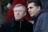 Photo Aidan Ellis. Digitalsport<br /> Manchester United v Portsmouth.<br /> FA Barclays Premiership.<br /> Old Trafford, Manchester.<br /> 26/02/2005.<br /> United manager Alex Ferguson and assistant Carlos Quierez discus tactics before the kick off