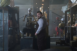 """Uncle Jonathan (Jack Black) with a collection of objects that aren't quite what they seem in """"The House With A Clock in Its Walls,"""" (2018)"""