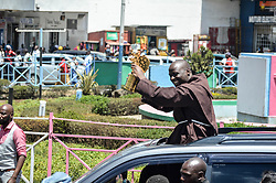 March 30, 2019 - Nakuru, Riftvalley, Kenya - Mr. Peter Tabichi who was named world best teacher is seen holding his trophy while greeting people when he arrived in Nakuru his home town where he was received by many..Mr Tabichi a Primary School teacher won $1 million Global Teacher Prize awarded by Varkey Foundation on March 24, in Dubai. (Credit Image: © James Wakibia/SOPA Images via ZUMA Wire)