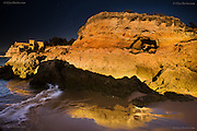 Fantastic caves, rock formations and sandy beaches located within Portimão's harbour walls where the river Arade joins the Atlantic Ocean.at the coast at Praia do Pintadinho near Ferragudo, Algarve, Portugal.