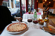 Pizza in a small restaurant, Paris, France.