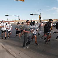 Participants in the Law Enforcement Torch Run for Special Olympics run on Route 66 Saturday morning in Gallup.