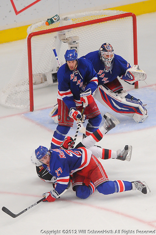 May 14, 2012: New York Rangers defenseman Ryan McDonagh (27) drops New Jersey Devils right wing Stephen Gionta (11) to the ice to clear him from screening New York Rangers goalie Henrik Lundqvist (30) during third period action in game 1 of the NHL Eastern Conference Finals between the New Jersey Devils and New York Rangers at Madison Square Garden in New York, N.Y. The Rangers defeated the Devils 3-0.