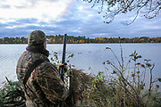 """Dave Evenson hunts over 49 wooden decoys at MacQuarrie Site No. 2, """"MacQuarrie Point"""" at Shallow Bay, Washburn County, WI. Eleven of the decoys in the spread were owned and used by Gordon MacQuarrie and the ODHA, Inc."""