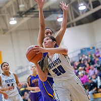 Miyamura Patriot Tia Washburn (20)attempts a shot on the baseline on the Kirtland Central Broncos at Miyamura High School in Gallup Thursday.