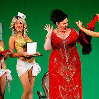 Picture shows : Karen Cargill as Isabella with bunny girls..Picture  ©  Drew Farrell Tel : 07721 -735041..A new Scottish Opera production of  Rossini's 'The Italian Girl in Algiers' opens at The Theatre Royal Glasgow on Wednesday 21st October 2009..(Soap) opera as you've never seen it before.Tonight on Algiers.....Colin McColl's cheeky take on Rossini's comic opera is a riot of bunny girls, beach balls, and small screen heroes with big screen egos. Set in a TV studio during the filming of popular Latino soap, Algiers, the show pits Rossini's typically playful and lyrical music against the shoreline shenanigans of cast and crew. You'd think the scandal would be confined to the outrageous storylines, but there's as much action off set as there is on.....Italian bass Tiziano Bracci makes his UK debut in the role of Mustafa. Scottish mezzo-soprano Karen Cargill, who the Guardian called a 'bright star' for her performance as Rosina in Scottish Opera's 2007 production of The Barber of Seville, sings Isabella..Cast .Mustafa...Tiziano Bracci.Isabella..Karen Cargill.Lindoro...Thomas Walker.Elvira...Mary O'Sullivan.Zulma...Julia Riley.Haly...Paul Carey Jones.Taddeo...Adrian Powter..Conductors.Wyn Davies.Derek Clarke (Nov 14)..Director by Colin McColl.Set and Lighting Designer by Tony Rabbit.Costume Designer by Nic Smillie..New co-production with New Zealand Opera.Production supported by.The Scottish Opera Syndicate.Sung in Italian with English supertitles..Performances.Theatre Royal, Glasgow - October 21, 25,29,31..Eden Court, Inverness - November 7. .His Majesty's Theatre, Aberdeen  - November 14..Festival Theatre,Edinburgh - November 21, 25, 27 ...Note to Editors:  This image is free to be used editorially in the promotion of Scottish Opera. Without prejudice ALL other licences without prior consent will be deemed a breach of copyright under the 1988. Copyright Design and Patents Act  and will be subject to payment or legal action, where appropriate..Further further inf