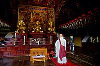Buddhist monk praying, Singhung-sa Temple, Mt. Soraksan National Park, South Korea