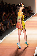 A short jumpsuit in yellow with a multi-colored cape top.