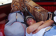 11 MAY 2002 - BUCKEYE, ARIZONA, USA: Robert Brashears, a college student from Douglas, AZ, sleeps in the back of his pickup truck before competing in the team roping at the Arizona West PRCA Rodeo in Buckeye, AZ, May 11, 2002. It was the first year for the Arizona West PRCA Rodeo..PHOTO BY JACK KURTZ