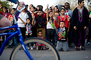Fans lining Davis Street cheer for beads at the fifth-annual Oak Cliff Mardi Gras Parade on Sunday, February 10, 2013 in Dallas, Texas. (Cooper Neill/The Dallas Morning News)