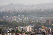 The houses and haze of Kathmandu, Nepal, as seen from Swayambhunath Temple.