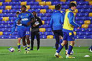 AFC Wimbledon defender Darnell Johnson (27) warming up prior to kick off during the EFL Sky Bet League 1 match between AFC Wimbledon and Gillingham at Plough Lane, London, United Kingdom on 23 February 2021.
