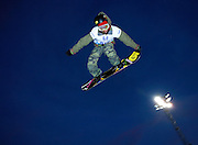 SHOT 1/26/08 5:29:57 PM - Japanese snowboarder Kazuhiro Kokubo (#377) of Sapporo, Japan grabs the tail of his snowboard while airborne high above the superpipe during practice for the elimination round Saturday January 26, 2008 at Winter X Games Twelve in Aspen, Co. at Buttermilk Mountain. Kokubo qualified seventh for the finals with a score of 72.33. The 12th annual winter action sports competition features athletes from across the globe competing for medals and prize money is skiing, snowboarding and snowmobile. Numerous events were broadcast live and seen in more than 120 countries. The event will remain in Aspen, Co. through 2010..(Photo by Marc Piscotty / © 2008)