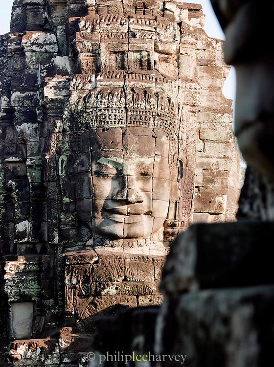 A stone face built into the Bayon Temple at Angkor, Cambodia