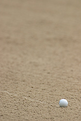 28 June 2005:  Golf ball rolls across a sand trap and leaves a trail.