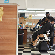 """DENMARK, SOUTH CAROLINA - JANUARY 22: Kevin Odom, owner of 'Big Kev's"""" barber shop, gives Tim Wright a haircut on an unseasonably cold afternoon in Denmark, SC on January 22, 2020.  Like many small rural towns, the barber shop was nearly the only shop open on the main road through town. (Photo by Logan CyrusforThe Washington Post)"""