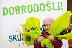 Child waiting for biathlon athletes with flowers at arrival to Airport Joze Pucnik from Vancouver after Winter Olympic games 2010, on February 26, 2010 in Brnik, Slovenia. (Photo by Vid Ponikvar / Sportida)