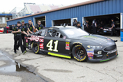 June 10, 2018 - Brooklyn, Michigan, U.S - Crew members of the Monster Energy/Haas Automation Ford driven by KURT BUSCH (41) push his car through the garage area at Michigan International Speedway. (Credit Image: © Scott Mapes via ZUMA Wire)