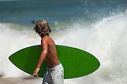 Skimboarder looking at surf, at the '07 Dewey Beach skimboarding championship.