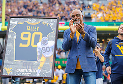 Oct 2, 2021; Morgantown, West Virginia, USA; Former West Virginia Mountaineer and former Buffalo Bill Darryl Talley is honored and has his number retired during the first half of their game against the Texas Tech Red Raiders at Mountaineer Field at Milan Puskar Stadium. Mandatory Credit: Ben Queen-USA TODAY Sports