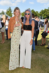 Left to right, CHARLOTTE BAER and EMILY WELLER at the Summer Solstice Party during the Boodles Tennis event hosted by Beulah London and Taylor Morris at Stoke Park, Park Road, Stoke Poges, Buckinghamshire on 21st June 2014.