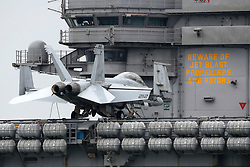 © Licensed to London News Pictures. 28/07/2017. USS George H.W. Bush (CVN 77) aircraft carrier <br /> <br /> The USS George HW Bush anchors in Stokes Bay near Portsmouth Harbour <br /> <br /> F-18 Hornet fighter aircraft <br /> <br /> Being partially protected by British Police in Boats . Photo credit: Jason Bryant/LNP