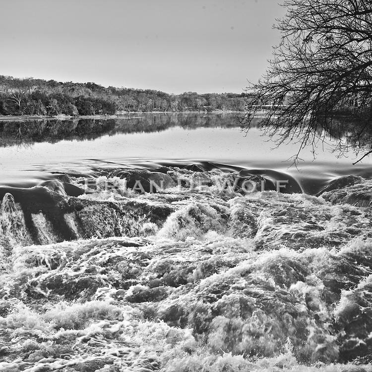 One can almost feel the force of rolling high water over a breach in the old Challenge facotry dam. The river is a This is the Fox River in Batavia, IL.