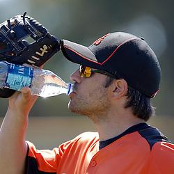 February 21, 2011; Sarasota, FL, USA; Baltimore Orioles second baseman Brian Roberts (1) drinks a bottled water during spring training at Ed Smith Stadium.  Mandatory Credit: Derick E. Hingle-US PRESSWIRE