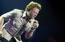 "Mick Hucknall/Simply Red live at Sheffields Hallam FM Arena during their 2003 ""Home"" Tour<br /> Michael James ""Mick"" Hucknall (born 8 June 1960) is an English pop singer and songwriter. Formerly the lead singer of the modestly successful punk rock band the Frantic Elevators, Hucknall achieved international fame in the 1980s as the lead singer and songwriter of the soul-influenced pop band Simply Red. They sold more than 50 million albums over a 25-year career. Their style drew upon influences ranging from blue-eyed soul, New Romantic and rock to reggae and jazz<br /> <br /> Copyright Paul David Drabble<br /> 03 May 2003"