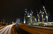Israel, Tel Aviv, Long exposure Night shot of Ayalon highway with light trails. Azrieli high rises in the background