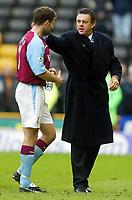 Photo: Scott Heavey.<br /> Wolverhampton Wanderers v Aston Villa. FA Barclaycard Premiership. 14/03/2004.<br /> Villa boss, David O'Leary congratulates Ronny Johnson