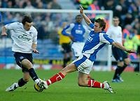 Photo: Gareth Davies.<br />Portsmouth v Everton. The Barclays Premiership. 09/12/2006.<br />Portsmouth's Sean Davis slides in on Everton's Simon Davies