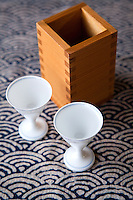 Sake set is a generic term for the flask and cups used to serve sake, the traditional Japanese drink made from rice. Sake sets are commonly ceramic, but may be glass, lacquer and even cedar wood.  The flask and cups may be sold individually or as a set.  The flask is called a tokuri and the cups are known as shoko in Japanese.