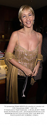 TV presenter TANIA BRYER at a party in London on 13th December 2000.OKF 102