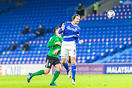 Cardiff City's Sean Morrison (4) heads clear during the EFL Sky Bet Championship match between Cardiff City and Birmingham City at the Cardiff City Stadium, Cardiff, Wales on 16 December 2020.