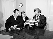An Taoiseach Dr Garret FitzGerald TD blows out the candles on his fifty-sixth birthday cake, watched by his wife Joan and son Mark.<br /> 9 February 1982