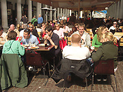 A51P9F Eating outside in Covent Garden London England