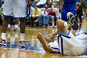 Nick Russell #12 of the SMU Mustangs lays on the found after a hard foul by the Memphis Tigers at Moody Coliseum on Wednesday, February 6, 2013 in University Park, Texas. (Cooper Neill/The Dallas Morning News)
