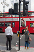 Pedestrians await a green light before crossing the road, on 21st September 2016, in Waterloo, SE1, south London borough of Southwark, England UK