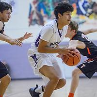 Miyamura Patriot Darin Baca (21) rushes past Aztec Tiger Jake Feil (2) Thursday at Miyamura High School.
